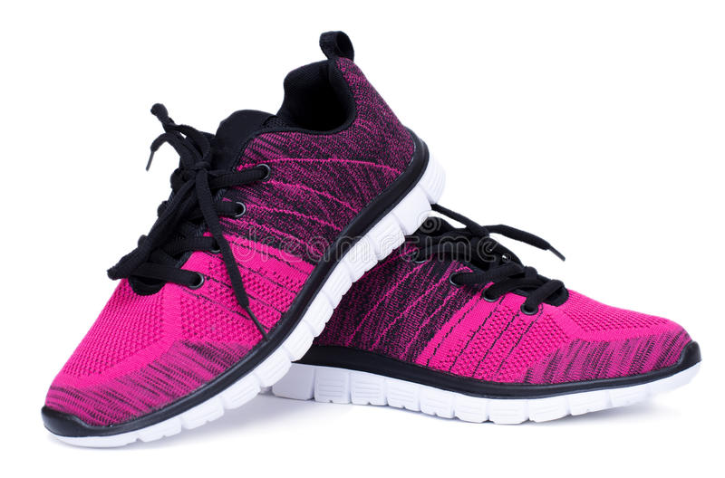 Pair of pink and black sport woman shoes isolated on white background. stock images