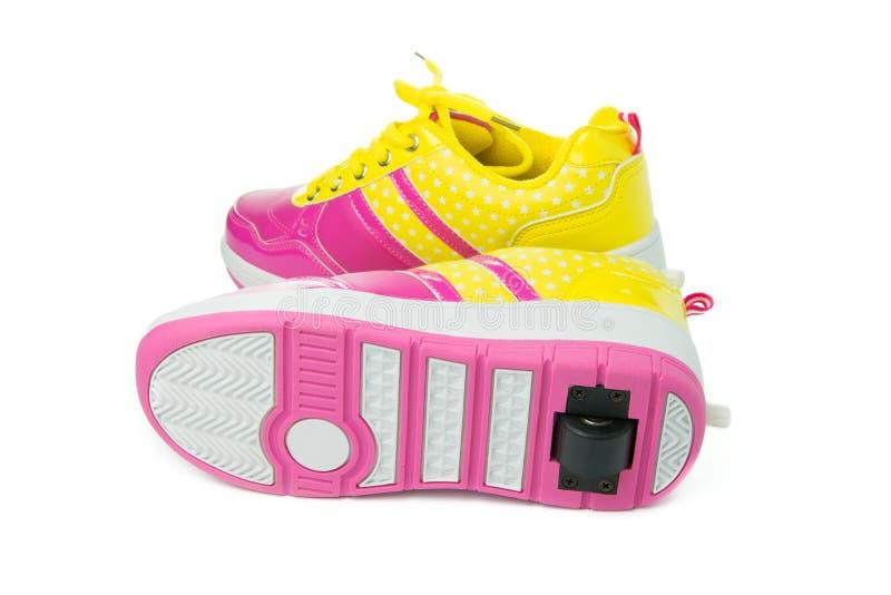 Pair of pink heelys stock image