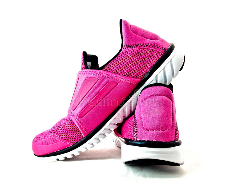Pair of pink lady sport shoes 1 stock photos