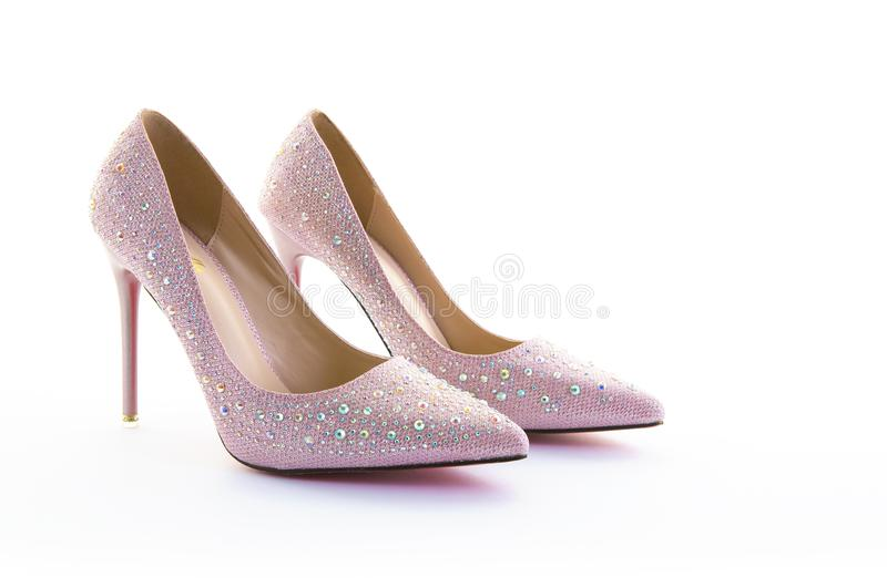 Pair of pink sparkly high heel shoes. On a white background stock photos