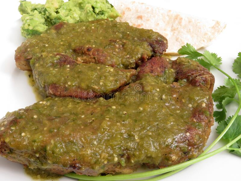 Pair of Pork Ribs for Dinner in Tomatillo Salsa royalty free stock photography