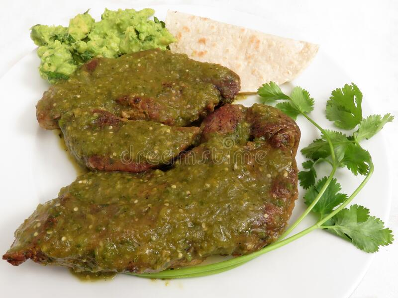Pair of Pork Ribs for Dinner in Tomatillo Salsa stock photography