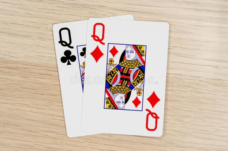 Pair of queens - casino playing poker cards royalty free stock photography