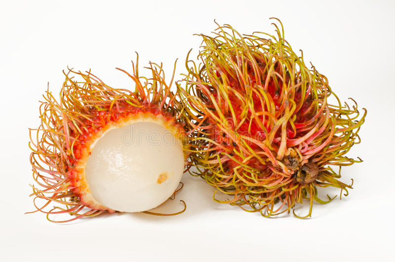 Pair of Rambutan. A picture of two Rambutan, one cut open, shot against a white background stock photography