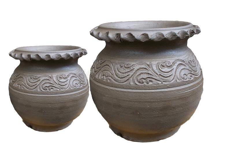 Pair of raw clay pots isolated on white backgrounds stock images