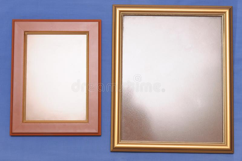 A pair of rectangular shaped photo frames with edges of different material. royalty free stock image