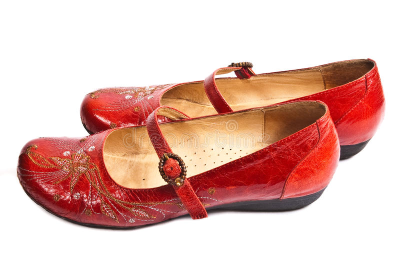 Pair of red embroided shoes. Pair of red embroided women shoes (low-heeled) isolated on white royalty free stock photo