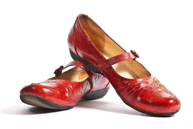 Pair of red embroided shoes. Pair of red embroided women shoes (low-heeled) isolated on white stock photos