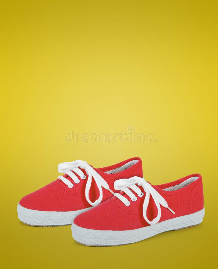 Pair of red unisex and kids sport shoes stock photo