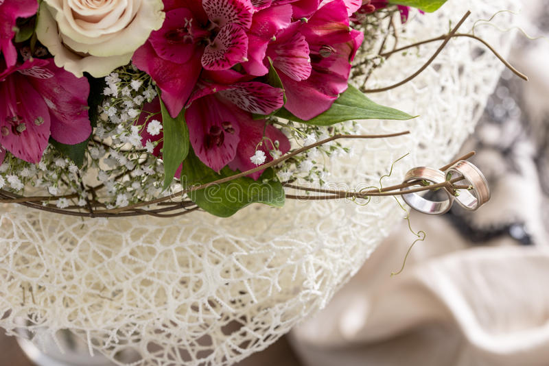 Pair of rings on branch of bouquet royalty free stock images