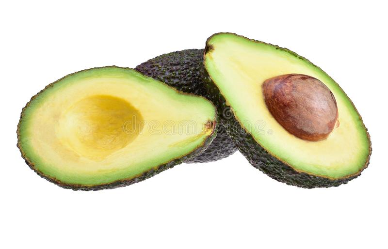 A pair of ripe avocados cut in half, on a neutral white background stock photography
