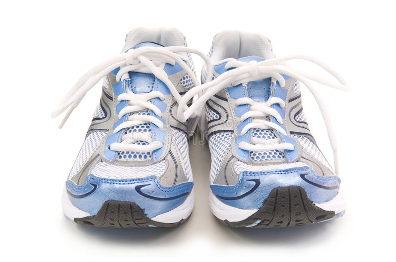 Pair of running shoes. Pair of blue running shoes on a white background stock photo