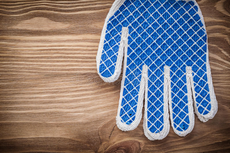 Pair of safety working gloves on wood board maintenance concept.  stock photo
