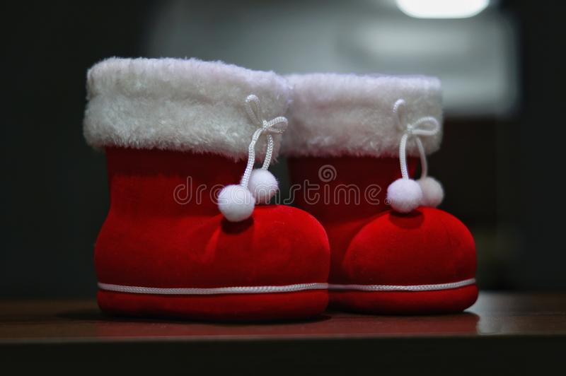 A pair of santa boot deco with dark background royalty free stock image