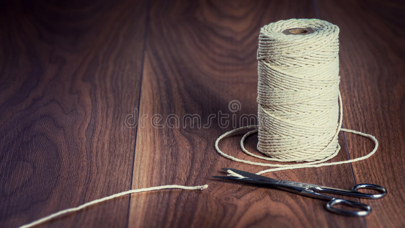 Pair of Scissors Cutting a Piece of String. royalty free stock photography