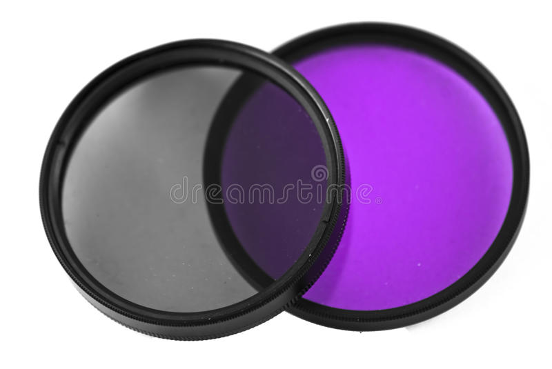 Pair of on filters. A pair of on 52mm Camera filters, one is a CPL and one is purple intensifier royalty free stock photography