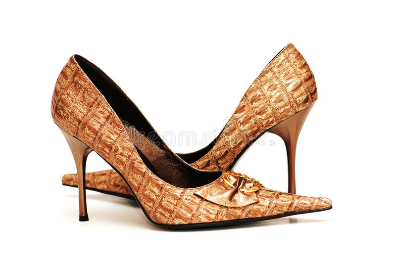Pair of shiny female shoes iso stock photography