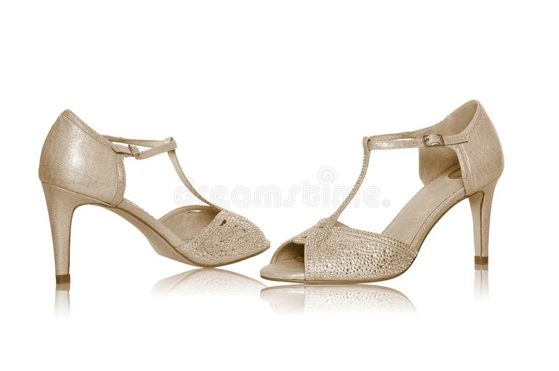 Pair of shiny high heels. A shoot of fashionable pair of high heels on white background stock image