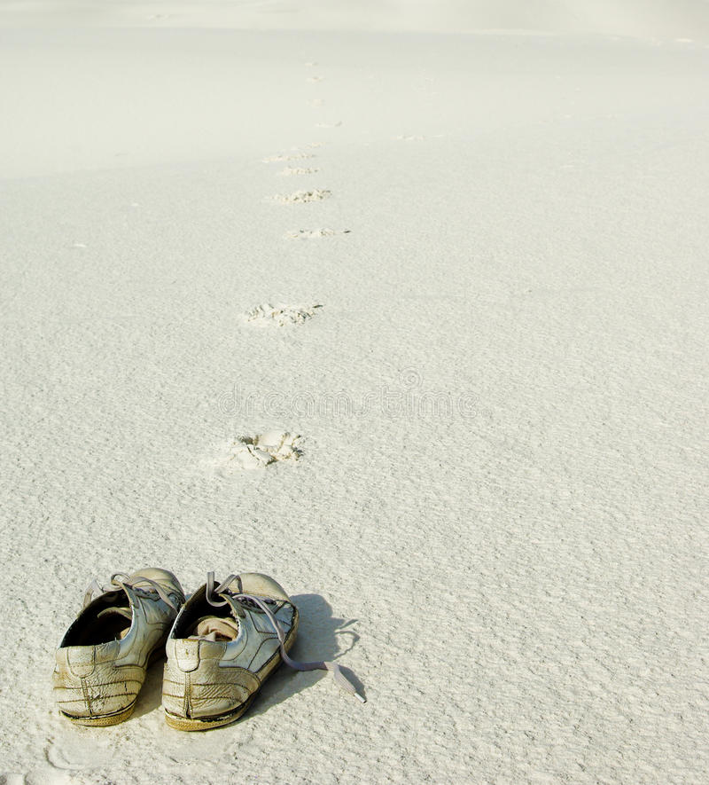 Pair of shoes on sand royalty free stock photos