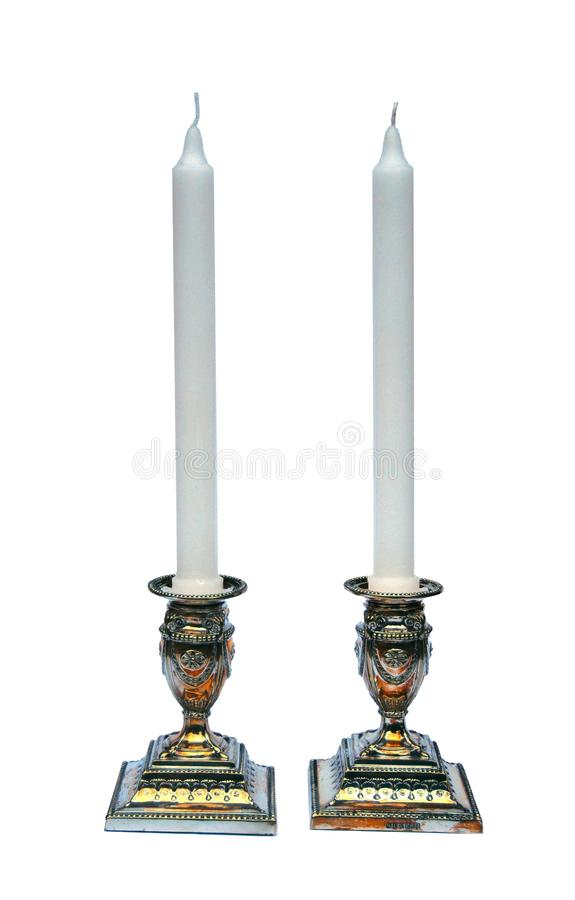 Pair of silver candlesticks isolated on white royalty free stock photos