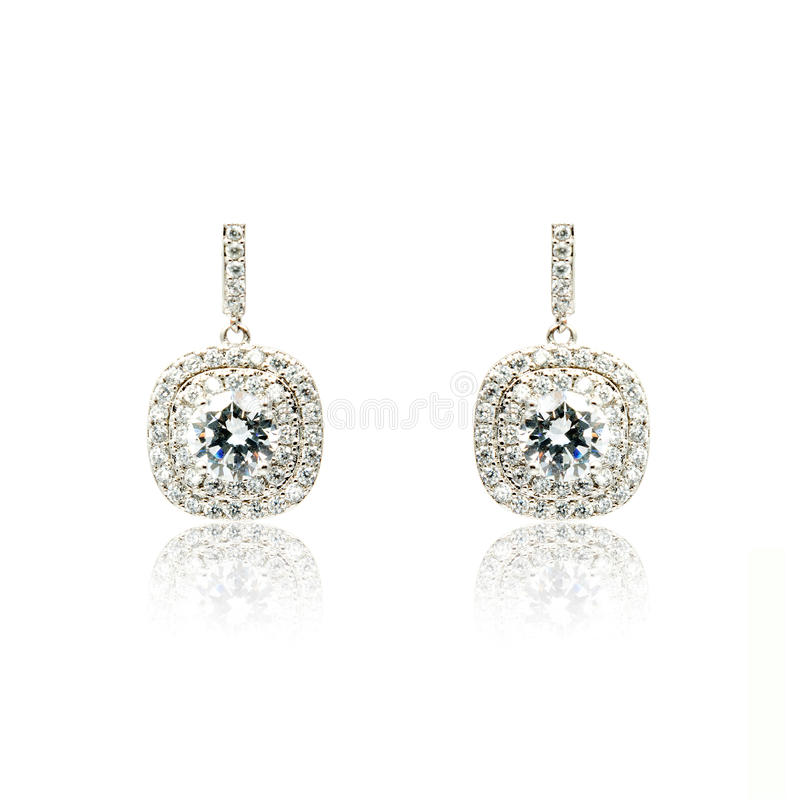 Pair of silver diamond earrings isolated on white royalty free stock images