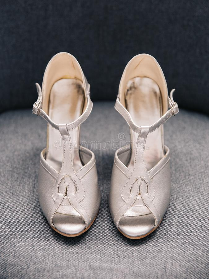 Pair of silver female high heeled wedding shoes stock photos