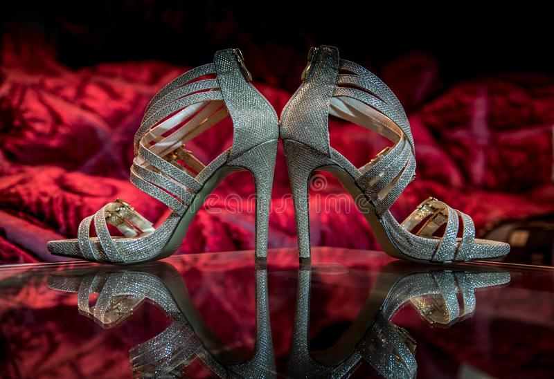 Pair of silver shoes with stiletto heels royalty free stock image