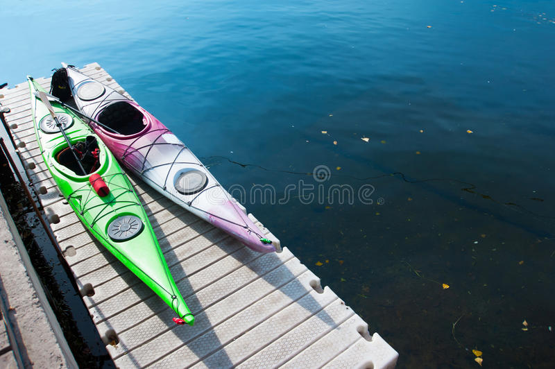 A pair of single kayaks in a row stock image
