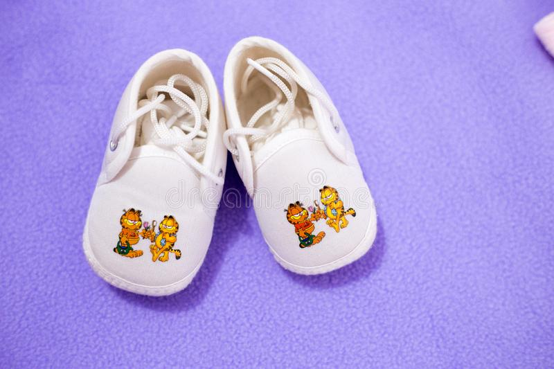Pair of small and cute baby shoes stock photo
