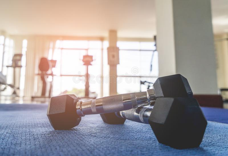Pair of Small dumbbell on fitness floor. Pair of Small dumbbell on fitness gym floor royalty free stock image
