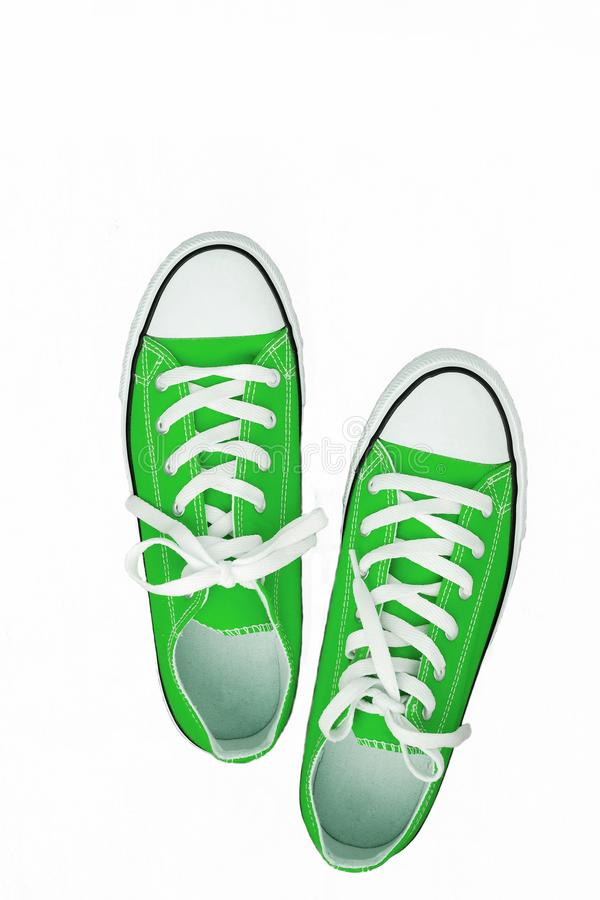 Pair of sneakers-colored youth running shoes on a white background, isolated.  royalty free stock photo