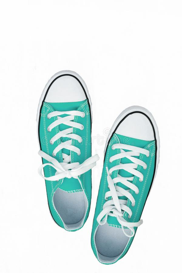 Pair of sneakers-colored youth running shoes on a white background, isolated.  stock photography