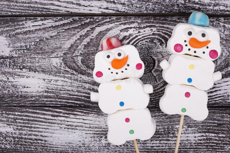 Pair of snowmen with space for text royalty free stock image