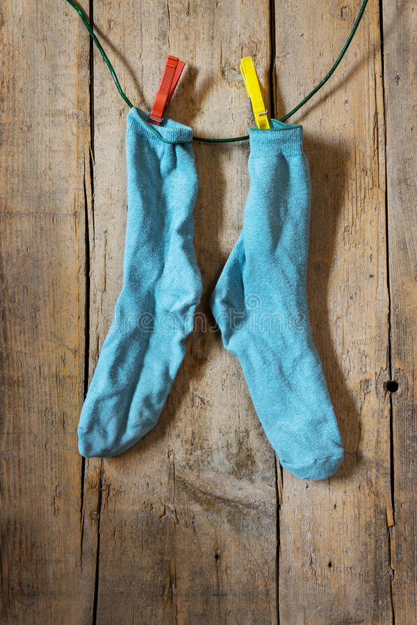 A pair of socks. On a wooden wall stock images