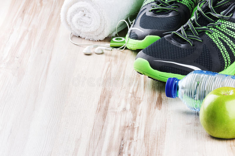 Pair of sport shoes and fitness accessories royalty free stock images