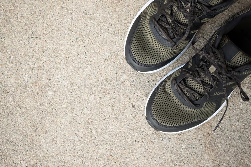 Pair of sport shoes on ground. Pair of green sport shoes on ground top view, flat lay royalty free stock photography