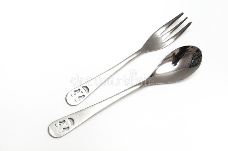 A pair of stainless steel cocktail spoon and fork. A photo taken on a pair of stainless steel spoon and fork against a white backdrop stock images