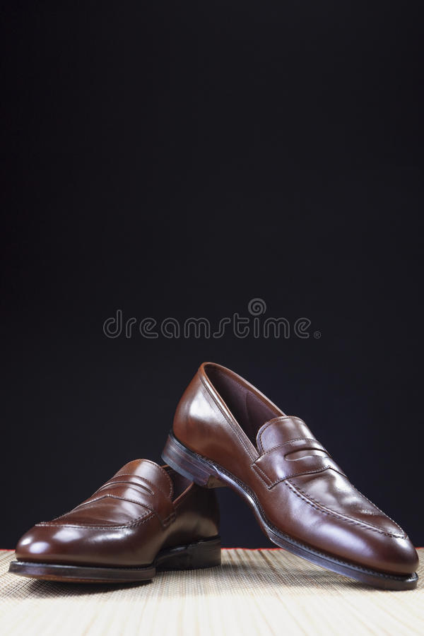 Pair of Stylish Expensive Modern Calf Leather Brown Penny Loafers Shoes.Closeup Shot stock photos