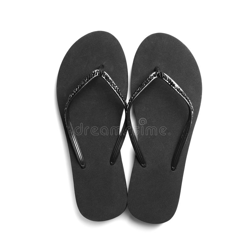 Pair of stylish flip flops on white background. Top view royalty free stock photography