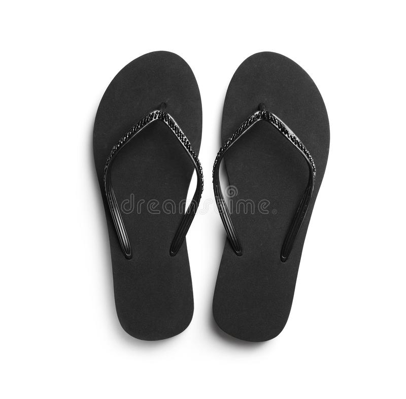 Pair of stylish flip flops on white background. Top view royalty free stock photos