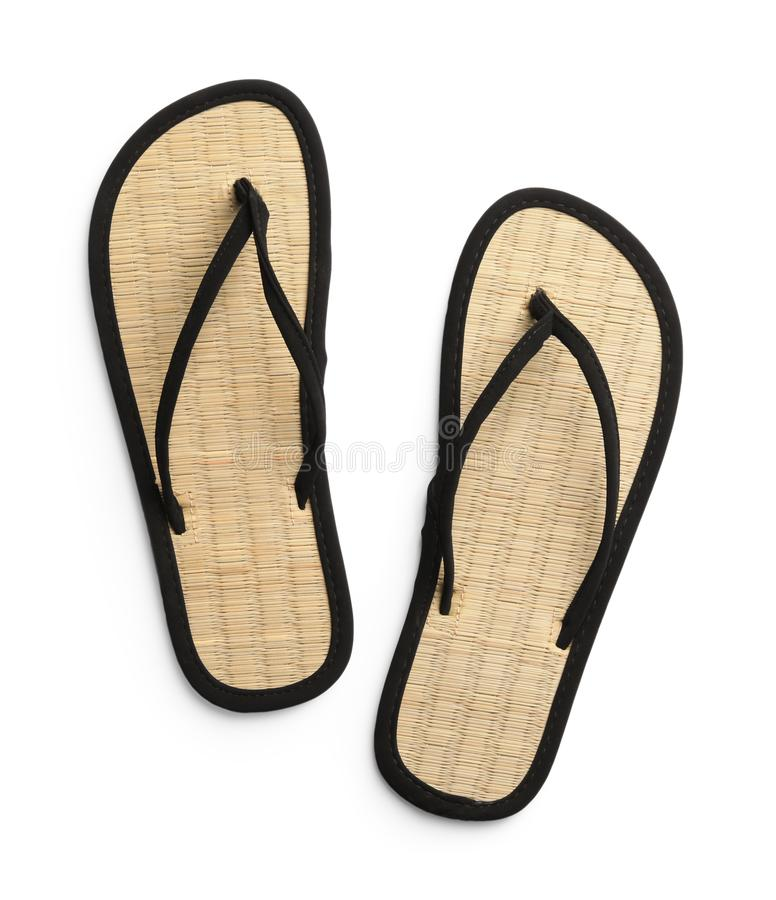 Pair of stylish flip flops on white background. Top view stock photography