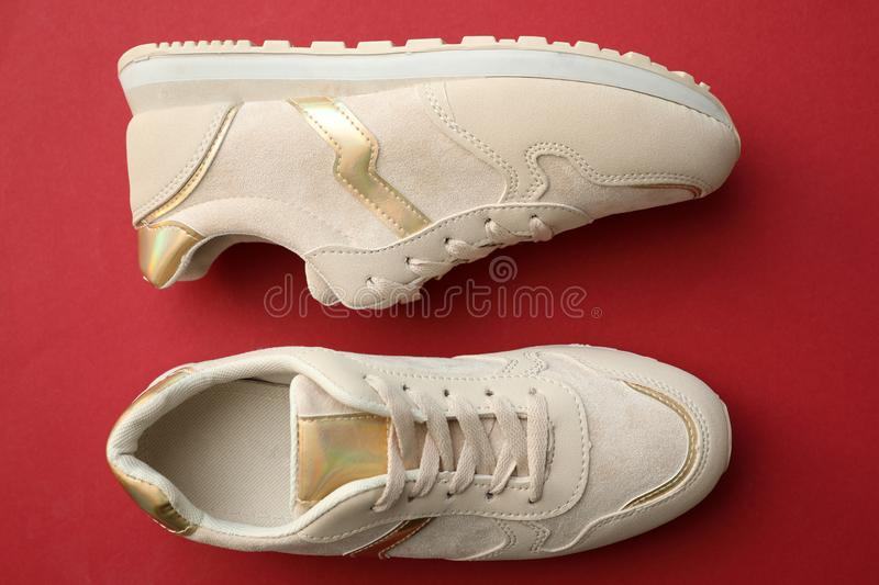 Pair of stylish shoes on red background. Top view stock photo