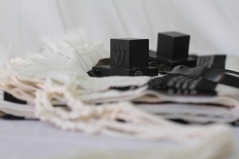 Pair of tefillin , A symbol of the Jewish people, a pair of tefillin with black straps, on a white background royalty free stock photo