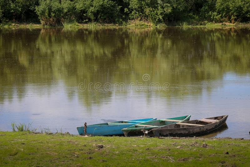Traditional boat on the river boat Desna in Ukraine. Pair of traditional wood boat on the river boat Desna in Ukraine stock photography