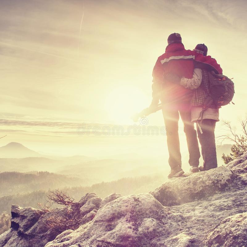 Polsko Pair of travelers on peak trail. Two photographers, a man and woman royalty free stock photo