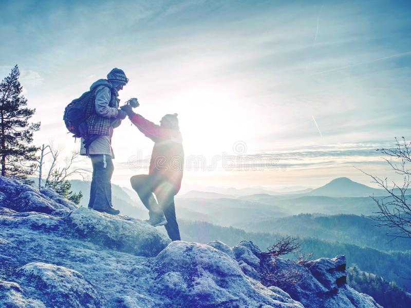 Pair of travelers on peak trail. Two photographers, a man and woman stock photo