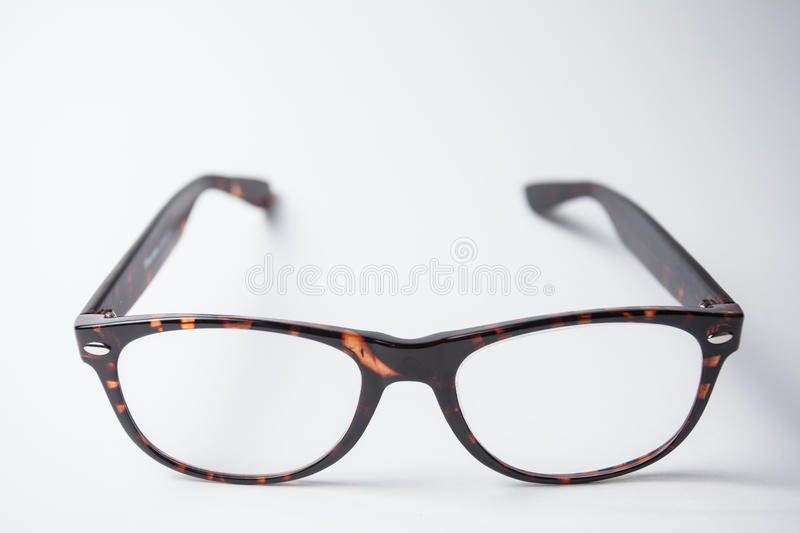 A pair of trendy brown eyeglasses stock images