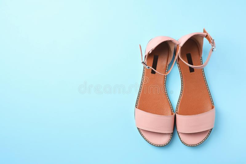 Pair of trendy women`s shoes on color background. Top view stock image
