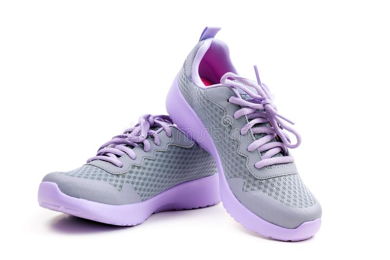 Unbranded purple running shoes on a white background. Pair of unbranded purple color sport or running shoes on a white background stock images