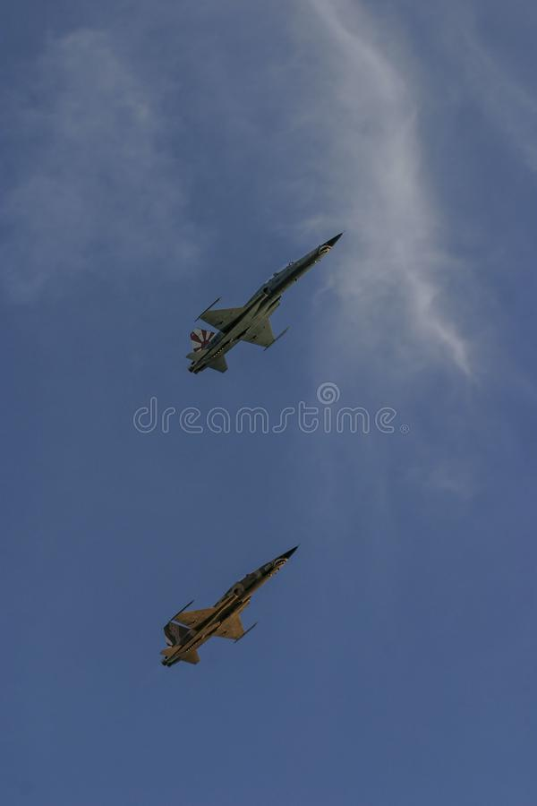 F-5 Fighters in flight. A pair United States Air Force F-5 fighter jets viewed from below as they fly in the sky over Florida in 2009 stock image